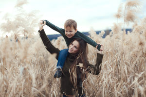 Mother and son outdoors in autumn